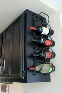 Instead of taking up space with a bar cart, hang a wire holder from the side of a cabinet. Even better? Hang it from the cabinet that holds the wine glasses so all the essentials are within reach after a long day. See more at Between 3 Sisters »
