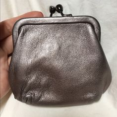 Perlina coin purse Small metallic purple coin purse. Two compartments, wear near the clasp and at the corners. Good condition, still a lot of life left. Perlina Bags Wallets