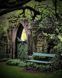 Secret garden with stone wall, pretty place to sit and a lovely green gate