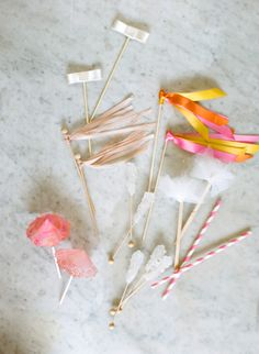 Fun cocktail stirrers: http://www.stylemepretty.com/living/2015/06/18/19-easy-garnishes-to-dress-up-your-drinks/