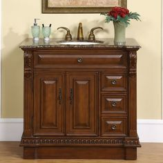 This single sink vanity with a Baltic brown granite top will surely give any bathroom the attention and appeal that it deserves. Th magnificent empire style of this vanity with carvings along the legs and edges will be a focal point of your bathroom.