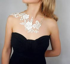 This beautiful lace and silver pearl charm bib necklace is a unique design and made by hand. It has vintage/modern style blended together.Great quality, ideal as a gift ! or for everyday/party/wedding wear! Gorgeous floral lace and pearl beaded lace necklace. shoulder piece. back charm.