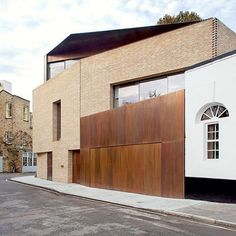 Brick and rust paneling from the Levring House by Jamie Fobert architects #wantinspired #fall #rust #architecture #jamiefobert #london #bloomsbury