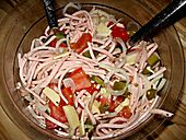 Wurstsalat. Sour German sausage salad with gherkins, marinated capsicum, cheese and onion. Made this last night and will likely be eating it all week! The recipe makes about 8 portions if you're adding salad greens or bread.