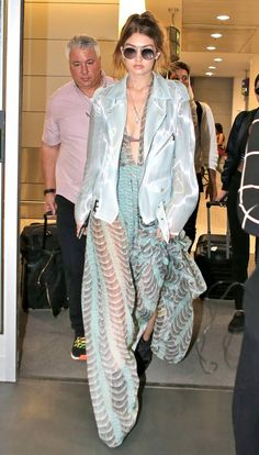 Gigi Hadid miraculously makes a sheer gown seem like your average airport attire, and we're not mad about it