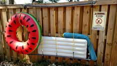 Pool float storage. I made this with PVC pipe and fittings (think 2 giant shower curtain rods) with bungee cords in between. Nice and tidy.