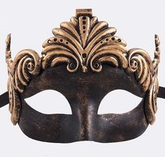 Ornate gold and black Fleur de Lis mask with metal finish. Black silk ribbon ties. 6' wide, 6.5 tall