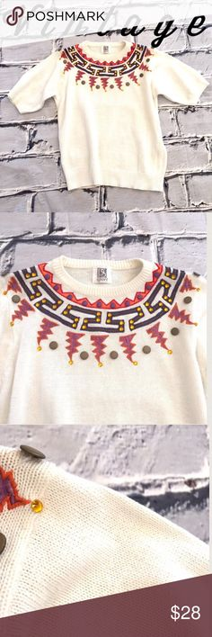 "Vintage Appliqué Short Sleeve Crewneck Sweater Wow! This sweater has appliqués, buttons, and bling! Short sleeve off-white knit. Teeny tiny snag in photo 3.  There's even Velcro in the shoulders just waiting for you to add some shoulder pads. This sweater does not have a size tag, so please read the measurements to make sure this will fit: armpit to armpit 18"" length 22"".  I'd call it a small. The brand is PS Sport. Vintage Sweaters Crew & Scoop Necks"