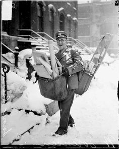 Mailman poses with his heavy load of Christmas mail and parcels, Chicago, 1929.