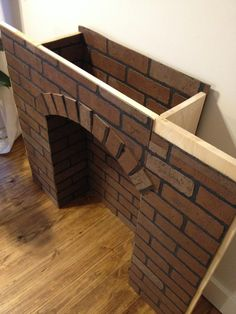 If You're Going to Make It, You Better Fake It--DIY Fake Brick Fireplace Fake it till you make it! This super fun DIY fake brick fireplace is sure to get the conversation started when guest come over and see it! Diy Christmas Fireplace, Fireplace Mantle, Fireplace Surrounds, Fireplace Design, Diy Faux Fireplace, Fake Mantle, Fireplace Ideas, Cardboard Fireplace, Fireplace Modern