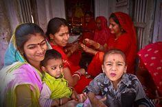 Festival day at the street corner shrine. Udaipur, India  www.mmjphotograph.com