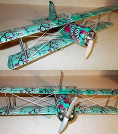 now this is very cool! I have seen a lot of crappy recycled DIY crafts... but this aluminum can plane is so well done, and a great inspiration to try! This one made with Arizona tea cans, but there are many others as well