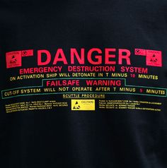 A three colour design, hand screen printed on a regular fit 100% cotton black T-shirt.