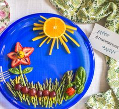 What a garden of eatin'! This kids lunch idea by @thenaturalnurturer is almost too pretty to eat. The flower is made of strawberry petals, a cherry tomato middle, asparagus stem, and basil leaves. It's accompanied by asparagus grass, an orange and carrot sun, grape and carrot caterpillar, and a grape tomato and olive ladybug on a basil leaf. #LunchboxLove
