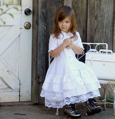 Love the delicate detail on the dress mixed with the big clunky boots :)