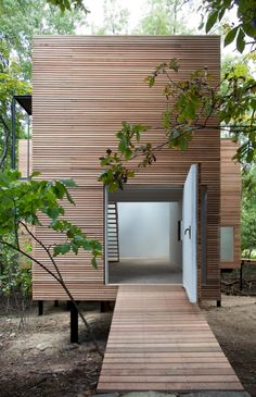 Cedar rain screen wraps around the building, Steven Holl, T Space Gallery