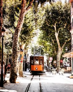 The town of Sóller in the north west coast Mallorca is famous for its orange marmelade and for the heritage Tranvía de Sóller - one of the two first generation tramways to survive in Spain (the other being Tramvia Blau in Barcelona). It was opened in 1913 and connects Sòller with the coastal village of Port de Sóller. With the population of only 14k people Sòller is one of the smallest European towns with an urban tramway system. For @instagram #whppostcard