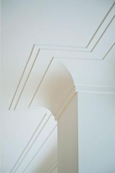 This is another example of a cove style crown moulding but with a double layer of buildup on the ceiling.