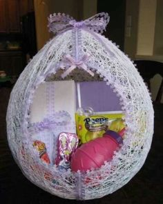 Make your own egg easter basket.  Get a regular size balloon and blow it up to the size you want. Use any type of string and wrap it around the balloon all different ways. When yiur done wrapping the balloon use water down glue and coat the whole thing. Let dry. Once its dry pop the balloon and cut a hole for your basket opening. Line your cut out edge with your choice of lace and decorate it how you want.