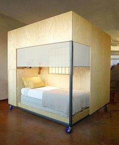 A cool mobile, private sleeping place when you have a loft style home office.