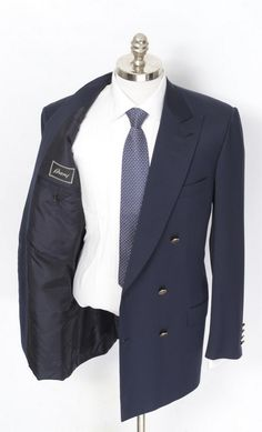 This Brioni Blaminio solid navy wool double-breasted blazers boasts broadest peak lapels.  |  Find yours! http://www.frieschskys.com/blazers  |  #frieschskys #mensfashion #fashion #mensstyle #style #moda #menswear #dapper #stylish #MadeInItaly #Italy #couture #highfashion #designer #shopping