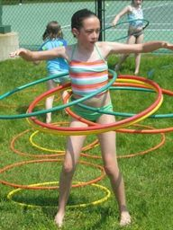 hula hooping with as many as you could master. :)