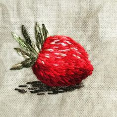 A tiny wild strawberry! _ _ _ #stitches #threadpainting #strawberry # #embroidery #embroideryart #contemporaryembroidery #textileart…