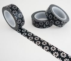Single roll of washi masking tape with black flowers pattern. Great for travel journals, scrapbooking, gift wrapping, decorating cards and envelopes and more! Add a little dash of cuteness to any craf