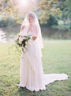 Photo by Cassidy Carson, floral design by Kelly Lenard, gown from Sarah Seven, veil from Mignonette Bridal