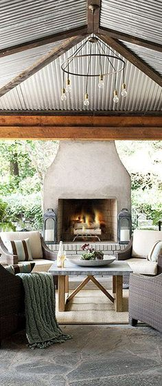 #OutdoorFireplaces Outdoor Fireplace....would love to listen to rain on this roof:). Beautiful.
