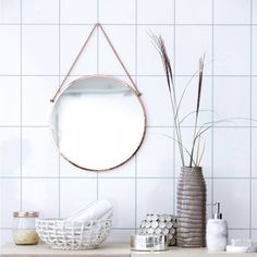 We love the Scandinavian simplicity of this round Bolina mirror from Denmark.The metal chain adds a retro touch, whilst the copper round shape is contemporary and on trend. This stunning mirror has a 16cm hanging chain and is available in a copper, silver and brass finish. Perfect for any room of house from the bathroom, to the living room and dining room, the simplicity of the design is extremely appealing and very versatile. To clean, please use a soft cloth and glass cleaner.100% glass…