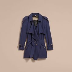 Silk Wrap Trench Coat - A silk trench coat characterised with an asymmetric wrap silhouette and oversize waterfall lapels and gunflaps for a light, fluid drape. The elegant design is finished with signature heritage details including elongated epaulettes. An elegant layer for your weekday wardrobe. #Burberry