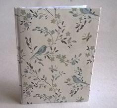 Mustikirja salataitoksella. Ohje löytyy verkosta: http://myhandboundbooks.blogspot.fi/2007/11/secret-fold-notebook.html