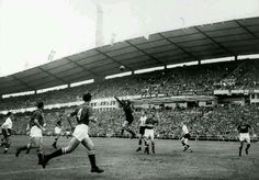 USSR 2 England 2 in 1958 in Gothenburg. Soviet keeper Lev Yashin punches away the cross in Group 4 at the World Cup Finals.