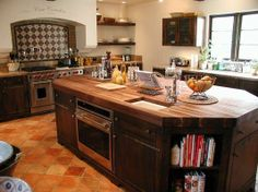 A custom kitchen in a historic home featuring distressed alder wood.