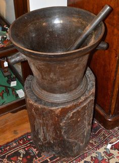 18th Century Cast Iron Mortar and Pestle Mounted on Stump