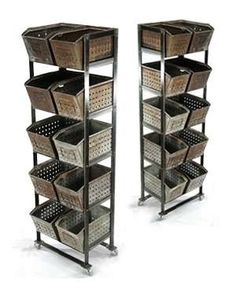 The steel bins once held ball bearings in a Detroit factory. They find a new use as multi-level organizers when placed in custom-made rolling frames created at the Garden Park forge. Photo courtesy Keith Merry, Garden Park Antiques - See more at: http://www.antiquetrader.com/features/urban_industrial_antiques#sthash.5v0g3phn.dpuf