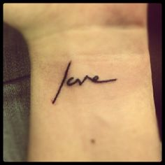 TWLOHA - Not the same script but same tattoo. Possibly different location.