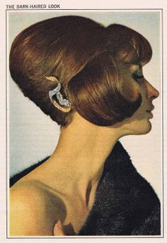 The 1960's saw some pretty unusual hairstyles. These creative updos were not at all like the stringy I-just-got-out-of-bed looks women wear today. Oh no. These hairstyles were perfectly coiffed and sprayed into complete submission, lest even one hair find it's own voice.  Combining forces with an array of hairpieces was quite common in 1964, when this hairstyle found its way into a McCall's Magazine. It is as if the model's hair was somehow strangely sectioned off into individual building…