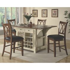 Give your kitchen that custom feel with this large scale Kitchen Island available in a black and cherry finish or buttermilk and cherry finish. This amazing piece features plenty of storage cabinets a