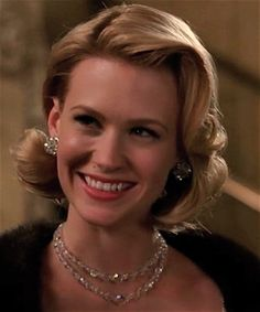 Betty in Season 2, episode 1, wearing a classic clear crystal with aurora borealis, color-changing coating crystal set.  This AB coating for crystals was not invented until 1955.