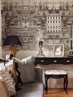 Love the wall paper and the black and white and gold palette