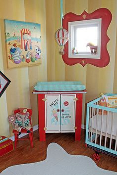 "Vintage Circus Nursery Changing Table....Corner of nursery with my changing table ""redo"". Turned a prim kitchen cabinet into a retro inspired ice cream cart. Giclee on canvas by Alison Jay. Elephant doll by artist Cindy Conrad."