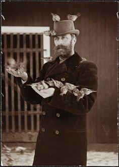 Norwegian zoologist Robert Collett (2 December 1842 – 27 January 1913) feeding birds.