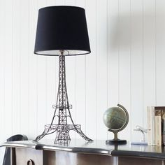 Vive la France! We love this unusual but stunning Eiffel Tower table lamp with black shade. This lamp is sure to make a statement in any room of the house.