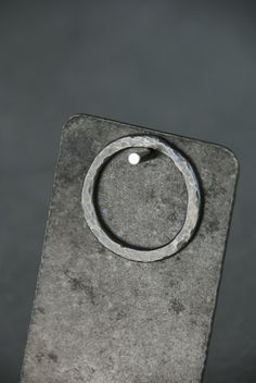Simple Circle: Blackened sterling silver circle has a hammered texture, and is also available without a patina.