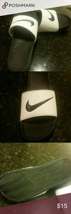 Nike flip flops size 8 Worn once to the mailbox. Don't fit me right. Size 8. Black and white. Bought 2 days ago at nike for 35. My loss is your gain!! Nike Shoes Sandals
