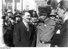 The Prince and the foot soldier: Adolf Hitler, the budding politician wearing the wrong tie, tries his developing magic on Prince Wilhem, Crown Prince of Germany, on March 21, 1933. Herman Goering is visible on the right in the photo. The officer in steel helmet with the white mustache, visible behind the Prince, is Gen. Hans von Seeckt.
