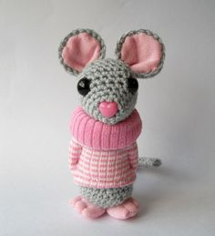 Amigurumi mouse, crocheted animal, plush miniature collectible soft sculpture.    Mollie is a gorgeous little crocheted mouse. She has been lovingly crocheted, wears a jumper sewn from a new sock, has sock details to her ears and has sculpted sock feet. She has toy safety eyes and a plastic safety heart shaped pink nose. She is stuffed with new hollow fibre toy filling and measures approximately 5.5 inches high.    Mollie has been made to my own original design and is intended as a soft…