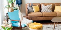 This living room is a little bit bohemian (thanks to a wicker ottoman, layered rugs, and saturated jewel tones), and a little bit midcentury — with a cognac leather couch from West Elm as the showpiece.